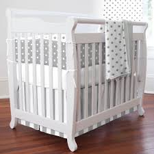 baby bedding sets gender neutral white wooden nursery shelves pad