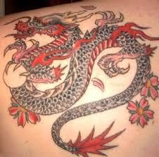 little pink flying dragon tattoo on leg tattooshunter com