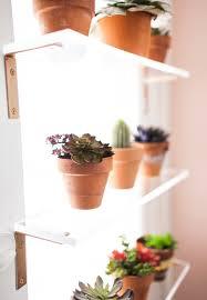 kitchen window shelf ideas simple spray painted brackets and plexi glass shelves in a window