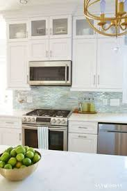 Gray Glass Tile Backsplash by Like The Idea Of Glass Tiles Behind Stove Up To Hood And Then