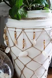 summer decorating with a bit of nautical fish net decor