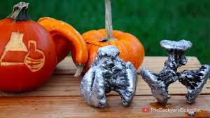 pouring molten aluminum into a pumpkin cooled with liquid