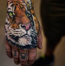 best 25 tiger hand tattoo ideas on pinterest rose hand tattoo