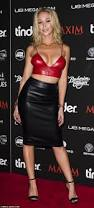 emily scott shows off cleavage in leather bralette at maxim u0027s