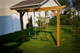 outdoor backyard with garden and swings right and then plant