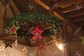 christmas wreath hanging from wooden barn ceiling stock photo
