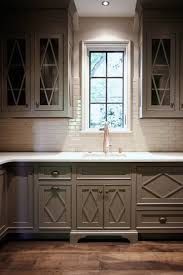 Diamond Kitchen Cabinets by Gray Kitchen Boasts Gray Cabinets With Glass Front Upper Cabinets