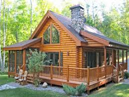 one story log home with wrap around porch