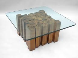 stacked wood glass top coffee table in the style of paul evans for