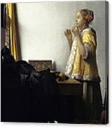vermeer pearl necklace woman with a pearl necklace painting by johannes vermeer