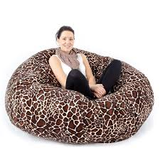 oval blue velvet bean bag with long pillow for two people placed