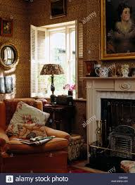 comfy armchair beside fireplace in victorian style living room