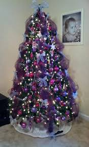 our tree this year pink purple and silver tulle is a