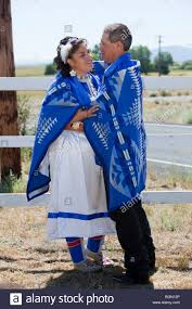 native american newly wed couple dressed in traditional clothing