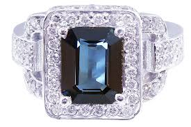 white gold green emerald and round cut diamonds ring art deco