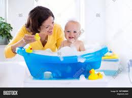 happy baby taking bath foam image photo bigstock