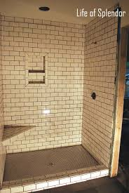 subway tile walls dark floor bathrooms ideas about black tiles on