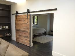 Hardware For Sliding Barn Doors Flat Track by Interior Brown Wooden Sliding Barn Door With Black Metal Rail And