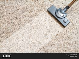 include the long beige carpet cleaning with a vacuum cleaner stock