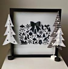 perfect white christmas tree with black decorations for both