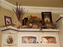 should i decorate on top of my kitchen cabinets the tricks you need to for decorating above cabinets