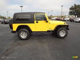yellow jeep wrangler unlimited solar yellow 2004 jeep wrangler unlimited 4x4 exterior photo