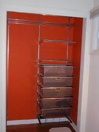floating orange closet with steel shelves with chrome basket also