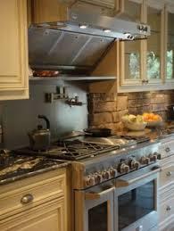 the rock backsplash is in still working on cabinets kitchen