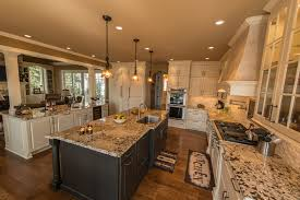 quartz countertops kitchen with 2 islands lighting flooring