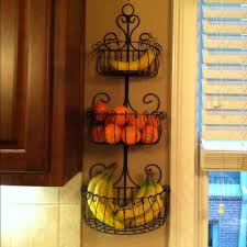 wall mounted fruit basket inserts the interior stylishly without