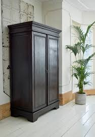 keraton carved wardrobe colonial style hand crafted dark teak our keraton carved wardrobe is handmade in indonesia and offers a striking addition to your bedroom
