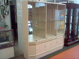 wall display cabinet with glass doors wall display cabinet with glass shelves 4 doors good condition