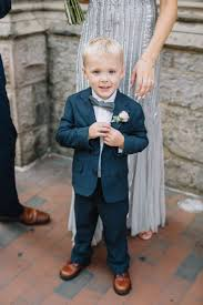 ring bearer wedding attire mismatched bridesmaids in grey for a city wedding ring bearer