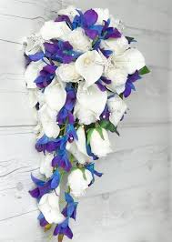 white and blue roses touch white roses and callas purple blue mokara