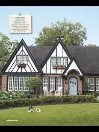 tudor home sharp paint job with blue door via hgtv mag homes