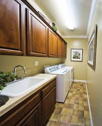 Cabinet Ideas For Laundry Room by Narrow Small Laundry Room With Neutral Wall Color And Wooden