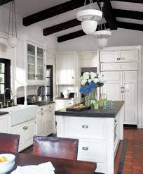 white sink black countertop kitchen countertops chopping board pendant lights kitchen island