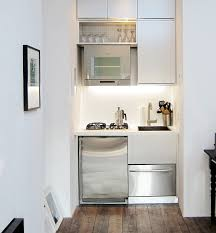 a tiny kitchen by mesh architectures occupies a nook in a 300