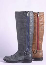 a crisp zipper silver studs and buckles galore when it