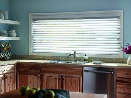 window wooden blindss plantation shades and faux wood kitchen at