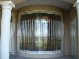 Hurricane Awnings Clear Corrugated Panels On Large Curved Window Hurricane