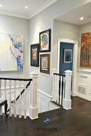 dark gray paint staircase with white spindles black hand rail artwork dark wood