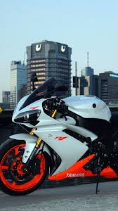 yamaha r1 wallpapers hd background yamaha r1 in white half orange color side view city
