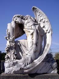 angel statue in the graveyard of trzic slovenia eschatology