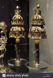 silver finials decorative bells attached to the end of torah