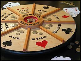 handcrafted wooden rummoli game board revolves on a lazy susan