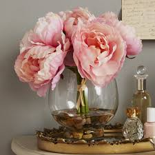 faux peonies ophelia co peonies in a glass vase with river rocks and faux