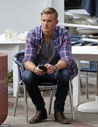 alexander ludwig sports plaid shirt and jeans as his show vikings