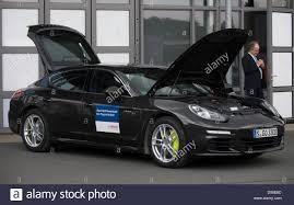 Porsche Panamera E Hybrid - the bonnet and trunk of a porsche panamera e hybrid are open