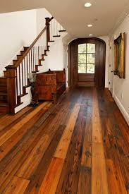 recycled wood foyer designed with white walls and recycled wood flooring go